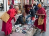 Monks at a sidewalk spice stall