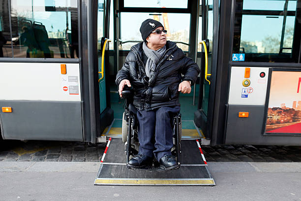 TO GO WITH AFP STORY BY ISABELLE TOURNE - Alain Ansellem, a disable person goes out of a bus on his wheelchair, on February 19, 2013 in Paris. French Prime Minister Jean-Marc Ayrault received on the first of March 1, 2013 from socialist senator Claire-Lise Campion a report on the accessibility of disabled people. AFP PHOTO KENZO TRIBOUILLARD        (Photo credit should read KENZO TRIBOUILLARD/AFP/Getty Images)