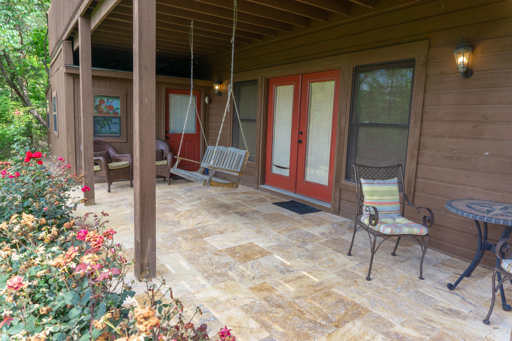 Smoky-Mountain-Splendor-lower-level-patio-from-yard-on-angle