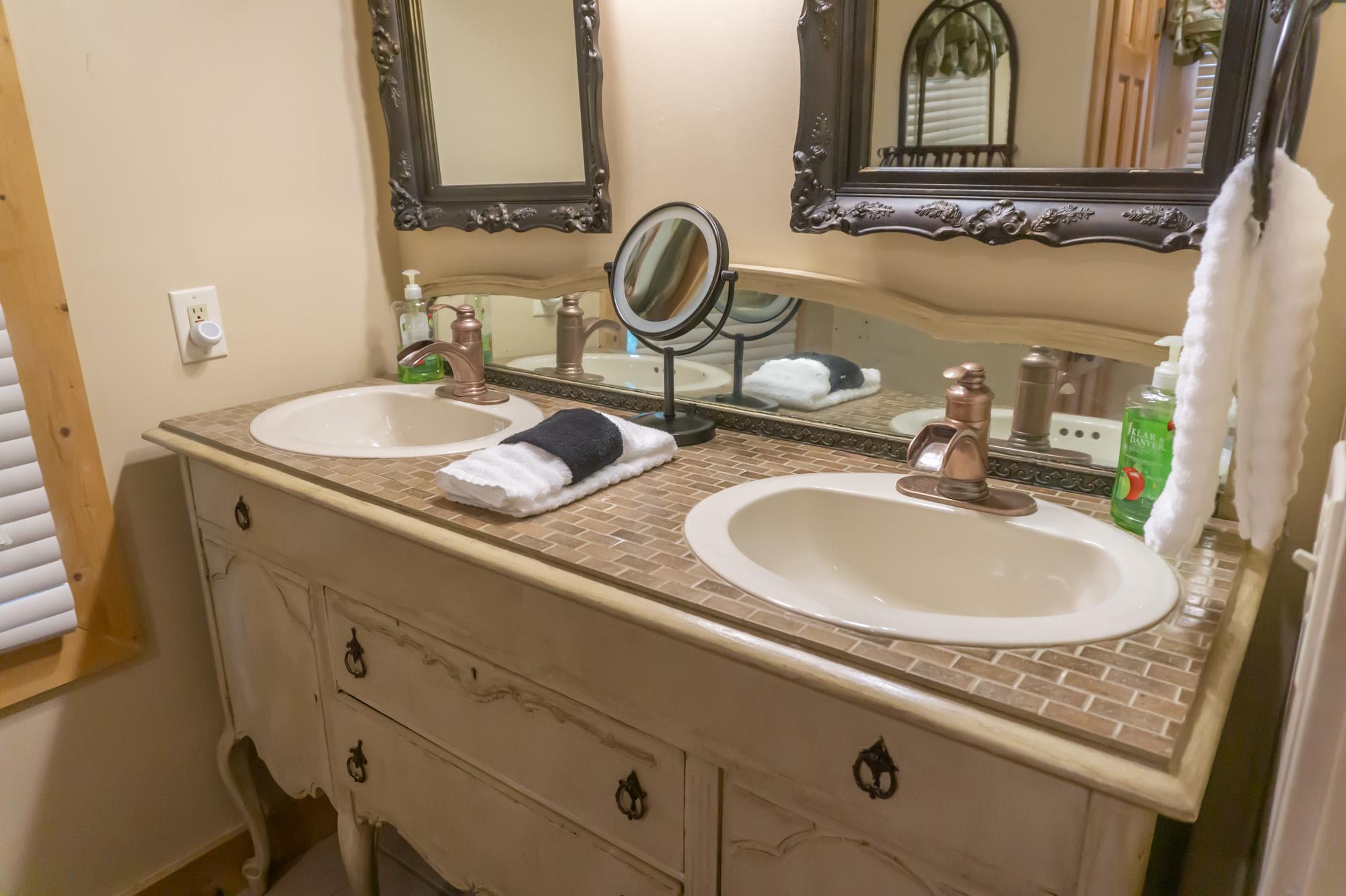 Smoky-Mountain-Splendor-main-level-bedroom-vanity-brass-faucets-waterflow