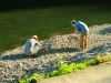 Young Men Skipping Rocks